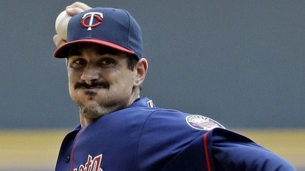 Carl Pavano, shown pitching in 2012 for Minnesota, is convalescing in a Connecticut hospital.