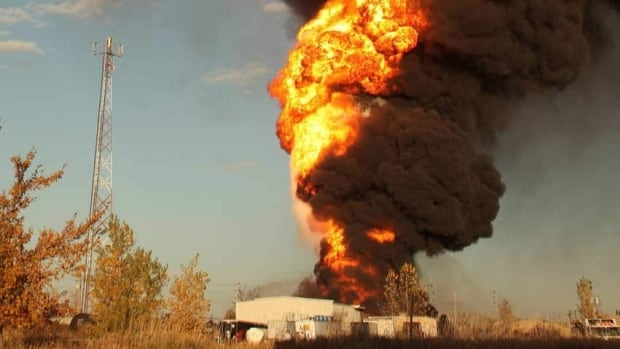 Fireballs and clouds of heavy black smoke were visible during the Oct. 1, 2012, blaze at the Speedway International racing fuel plant in St. Boniface. (Submitted)