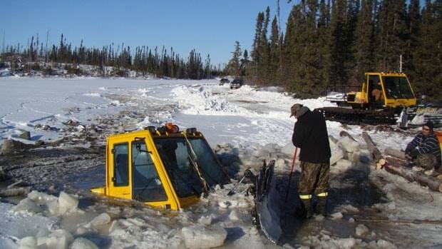 A picture of a groomer machine used to plow roads that fell through the ice near a northwestern Ontario First Nation last year. The two men on the machine managed to escape.