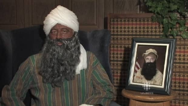 The video features a man in brown makeup wearing a turban, pretending to be Osama bin Laden's brother.