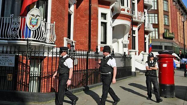 Police patrol Wednesday outside the Ecuadorian Embassy in London, where WikiLeaks founder Julian Assange has sought refuge seeking political asylum.