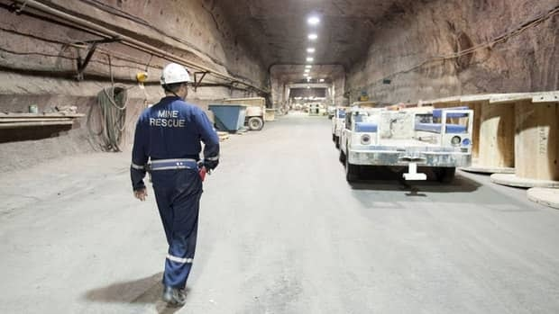 Rocanville PotashCorp underground production supervisor Dave Esslinger walks toward his work vehicle 1000 metres below the surface at the potash mine in Saskatchewan.