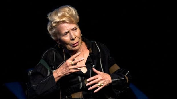 Joni Mitchell speaks at Toronto's Isabel Bader theatre as part of the city's Luminato Festival of Arts and Culture on Sunday.