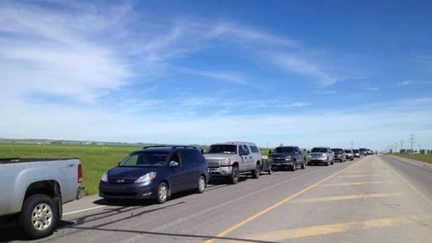 Residents returning to High River have been facing long lines.