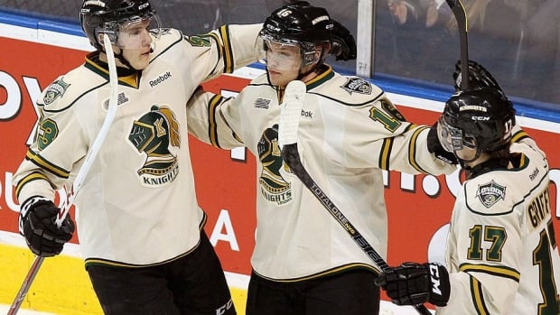 Knights left-winger Bo Horvat, right, and right-winger Seth Griffith celebrate a goal as Blades defenceman Dalton Thrower skates away in the first period during the Memorial Cup opener Friday night in Saskatoon. London scored a power-play goal in the third period to pull out a 3-2 win.