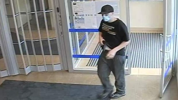 A robber wearing a surgical mask has been targeting ATM users in Surrey and White Rock.