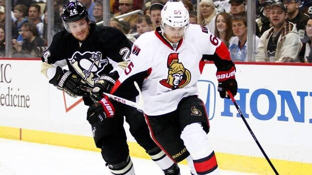 Erik Karlsson of the Ottawa Senators handles the puck in Game 1 in front of the opponent who put him out for more than two months with an Achilles injury, Matt Cooke of the Pittsburgh Penguins.