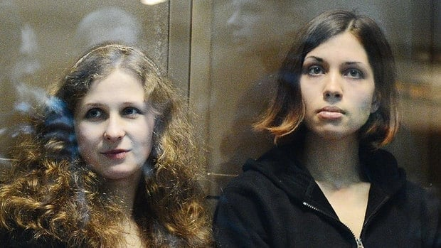 The two jailed members of the punk band Pussy Riot Maria Alyokhina, left, and Nadezhda Tolokonnikova, seen in a glass-walled cage in a Moscow court in October, gave rare interviews to a Russia newspaper.