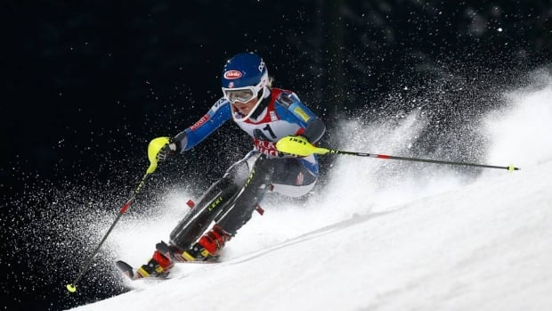 American Mikaela Shiffrin, middle, is flanked by Bernadette Schild, left, of Austria and Slovenia's Tina Maze, who placed third, after the women's slalom in Lenzerheide, Switzerland, on Saturday.