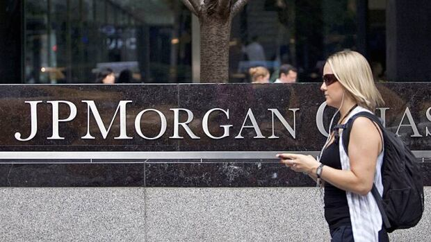 JPMorgan's profit would have been a lot higher in the fourth quarter were it not for legal costs, the bank says.