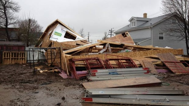 Strong winds in the Halifax area blew down a house under construction. Environment Canada issued wind warnings for Eastern Canada as a low-pressure system moves through.