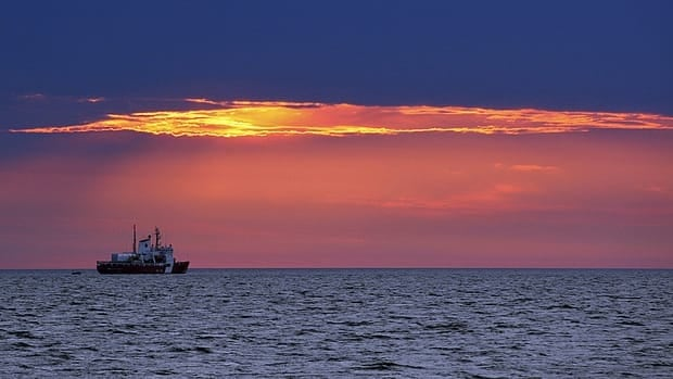 The Coast Guard CCGS Pierre Radisson is seen as the sun rises on the Hudson Bay near Churchill, Manitoba August 24, 2012.