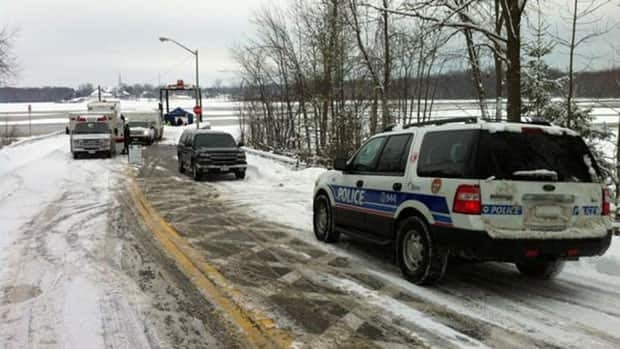 Police dive crews searched for possible signs that a vehicle may have gone in the Ottawa River.
