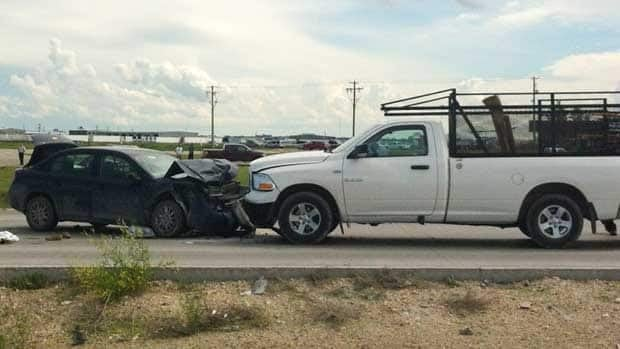 A 97-year-old woman was pronounced dead at the scene of this collision between a car and pickup truck on Wednesday.