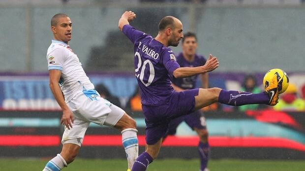 Borja Valero Fiorentina, right, competes for the ball with Gokhan Inler of Napoli at Stadio Artemio Franchi on January 20, 2013 in Florence, Italy.