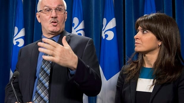"Jan. 15, 2013: Quebec Junior Social Services Minister Veronique Hivon, right, listened as lawyer and commission head Jean-Pierre Ménard, left commented on a report called ""Dying within dignity"" at the legislature in Quebec City."