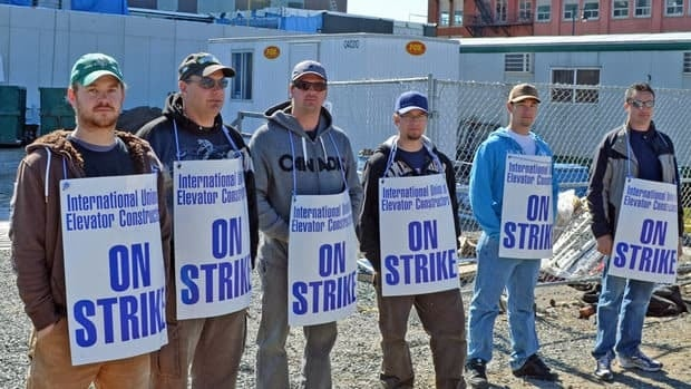 Members of the International Union of Elevator Constructors International set up picket lines Friday at the new courthouse currently under construction.