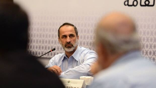 Head of the Syrian National Coalition for Opposition and Revolutionary Forces Mouaz al-Khatib speaks during a meeting in Istanbul, Turkey, Monday, March 18 2013.