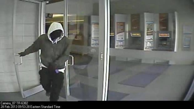 The bank robber got away with some cash and was last seen running towards Malden Road.