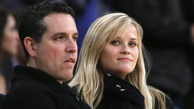 Reese Witherspoon has apologized for her behaviour to police that began when her husband, Hollywood agent Jim Toth, left, was arrested early Friday for driving under the influence of alcohol.