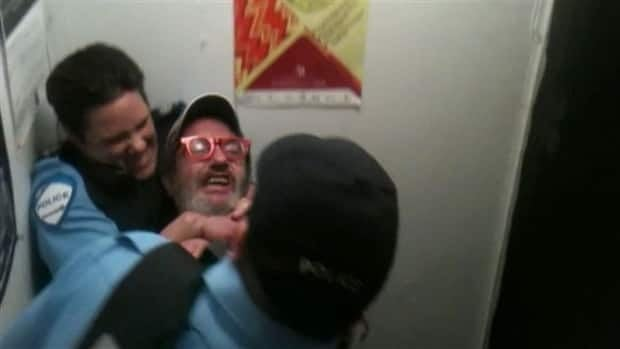 Constable Stéfanie Trudeau puts Serge Lavoie in a headlock during an intervention on Oct. 2, 2012.