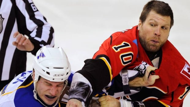 Calgary forward Brian McGrattan, right, played 19 games with the Flames last season.