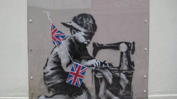 Acclaimed British graffiti artist Banksy created the stencil Slave Labour (Bunting Boy) on the side of a north London thrift shop in May 2012. Its removal for auction in February sparked widespread protest and led to its withdrawal from sale, but it sold on Sunday at a subsequent auction.