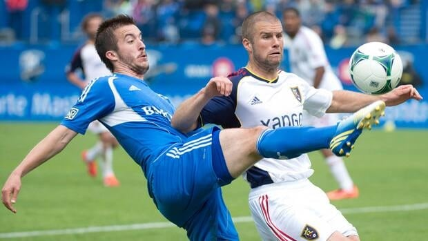 Montreal Impact's Jeb Brovsky fights for the ball with Real Salt Lake's Chris Wingert.