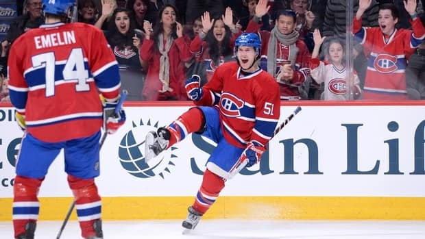 David Desharnais of the Montreal Canadiens, right, celebrates his second period goal against the Buffalo Sabres on Saturday.