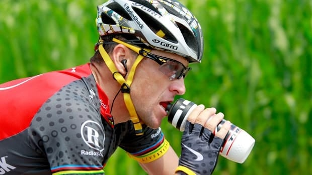 Lance Armstrong, seen cycling from Tournus and to Station des Rousses in the 2010 Tour de France, had a contentious relationship with Le Monde while competing.