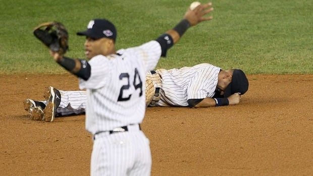 NY Yankees' Derek Jeter (right) broke his ankle at last fall in the AL championship series opener.