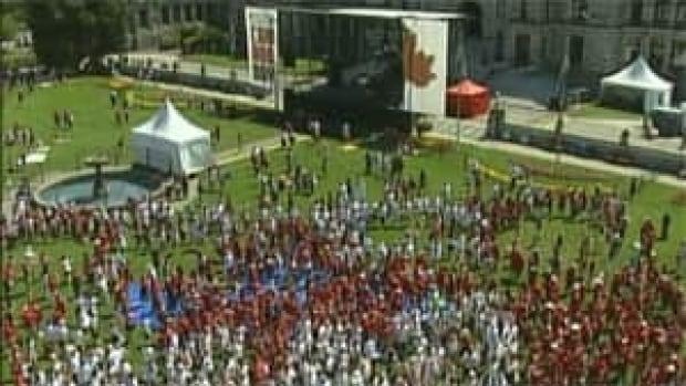 mi-bc-130703-legislature-living-flag-canada-day-bomb-plot-1
