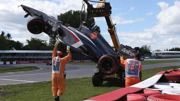 Track workers remove the car of Sauber driver Esteban Gutierrez of Mexico after a crash at the Canadian Grand Prix on Saturday.