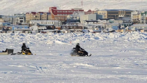 Prime Minister Stephen Harper is seen taking in the Iqaluit skyline by snowmobile in 2012. Canada will send five teams to the Venice Architecture Biennale to design ideas for building in the North.
