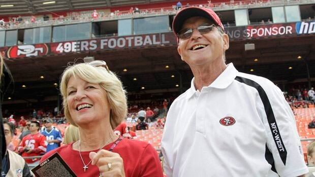 Jackie and Jack Harbaugh wore 49ers gear at this 2011 game, but they won't be wearing team colours of either side in the Feb. 3 championship game.