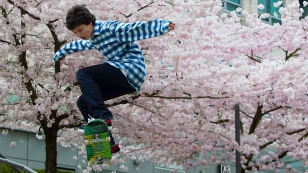 Fifteen-year-old Gareth Grainger skateboards as cherry blossom trees are in full bloom in downtown Vancouver, B.C., on April 9, 2011. Skateboards began as roller-skate wheels nailed to boards by teenagers, a home-grown product later adopted and improved by manufacturers for profit. The federal government wants to tap the skills of obscure basement inventors and turn their tinkering into innovative consumer products.