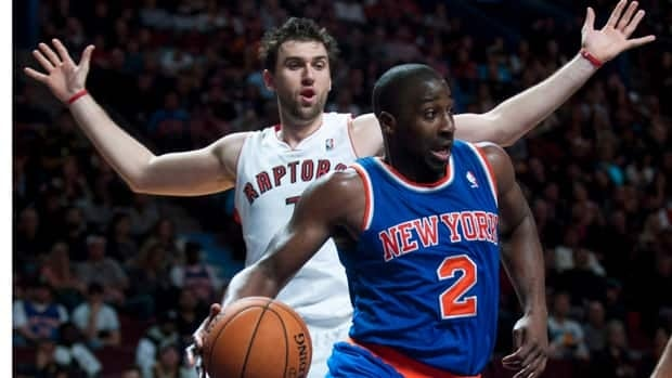 New York Knicks' Raymond Felton drives to net against Toronto Raptors' Andrea Bargnani during a preseason NBA game in Montreal last October.