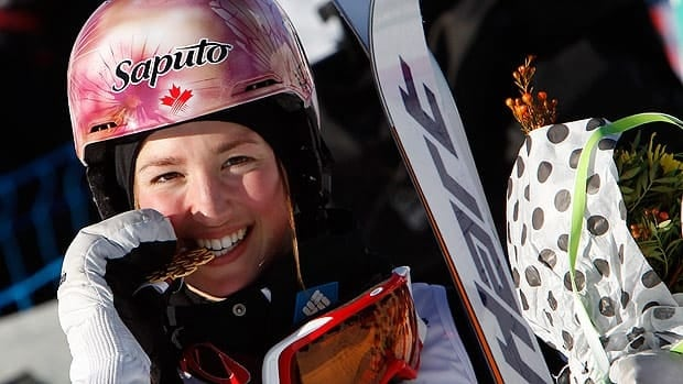 Chloe Dufour-Lapointe of Canada smiles with her gold medal after Friday's competition in Voss, Norway.