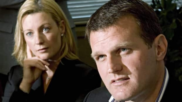 Former NHL star Vincent Damphousse speaks during his retirement announcement as his now-estranged wife Allana listens, during a news conference on Sept. 7, 2005 in Laval, Que.