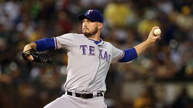 Matt Harrison of the Texas Rangers pitches against the Oakland Athletics on October 2, 2012 in Oakland, California.