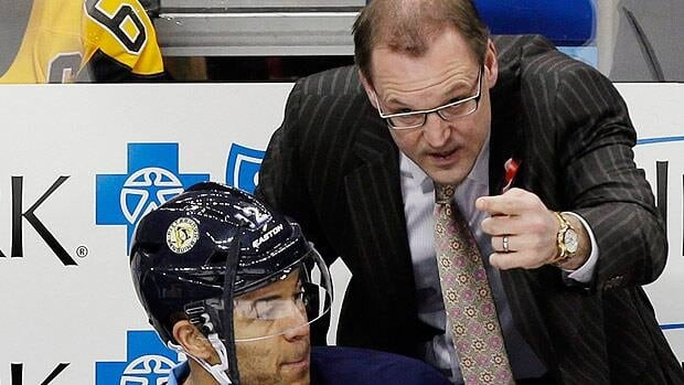 Pittsburgh Penguins head coach Dan Bylsma gives instructions to right wing Jarome Iginla during the first round of the playoffs.