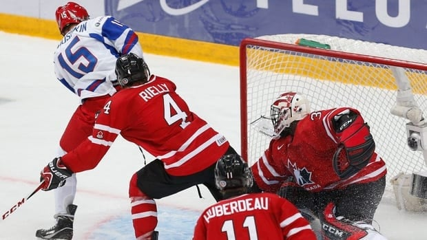 Russia's Valeri Nichushkin scores on Canadian goalie Malcolm Subban in overtime to capture bronze at the world junior hockey championships in Ufa, Russia on Saturday.