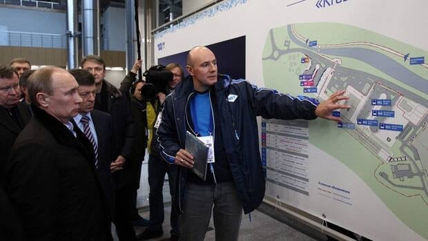 Russia's pladimir Putin, left, listens to Sochi 2014 CEO Dmitry Chernyshenko on a guided tour at the Krasnaya Polyana railway station near the mountain cluster for the Sochi Games.