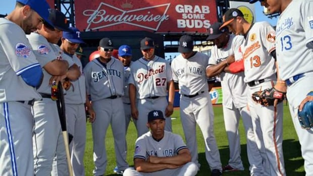 Major League Baseball tweeted this photo of Yankees legend Mariano Rivera surrounded by his American League teammates prior to the 2013 All-Star Game in New York. Rivera would go on to win MVP honours and several players tweeted congratulatory messages.