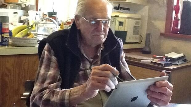 Charles Fisher, 98, decided last winter to start using the internet and quickly became a natural at operating his new iPad.