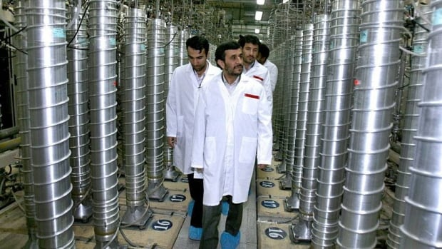 Iranian President Mahmoud Ahmadinejad visits the Natanz Uranium Enrichment Facility some 322 kilometers south of the capital Tehran in 2008. The dissident National Council of Resistance of Iran says that a secret underground nuclear site is being constructed 50 km northeast of Tehran.