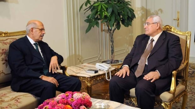 Mohamed Elbaradei, left, meets with interim president Adly Mansour, right, at the presidential palace. Apparently, the ultraconservative Salafi el-Nour party objected to ElBardei's appointment as prime minister and mediation is underway.