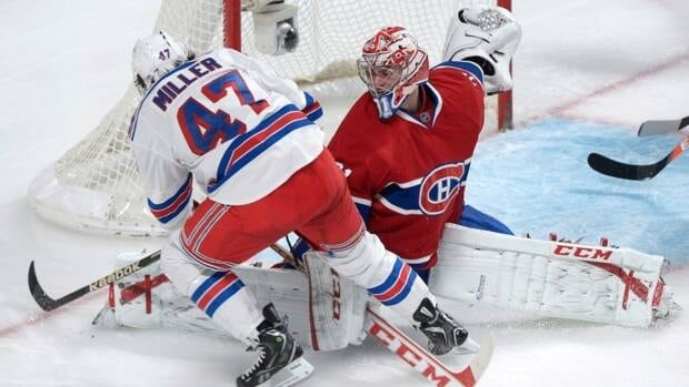 Montreal Canadiens goaltender Carey Price makes a save against New York Rangers forward J.T. Miller on Saturday night in Montreal.