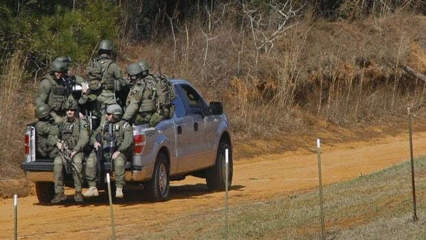 Law enforcement officials including the FBI were driven at the scene of the hostage-taking near Midland City, Alabama last week. Five-year-old Ethan was rescued Monday night after agents stormed the bunker where he was being held.