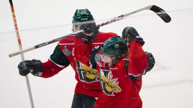 Halifax Mooseheads winger Stephen MacAulay congratulates Halifax Mooseheads centre Nathan MacKinnon after he scored his third goal against the Portland Winterhawks at the Memorial Cup in Saskatoon, Sask., on Saturday.